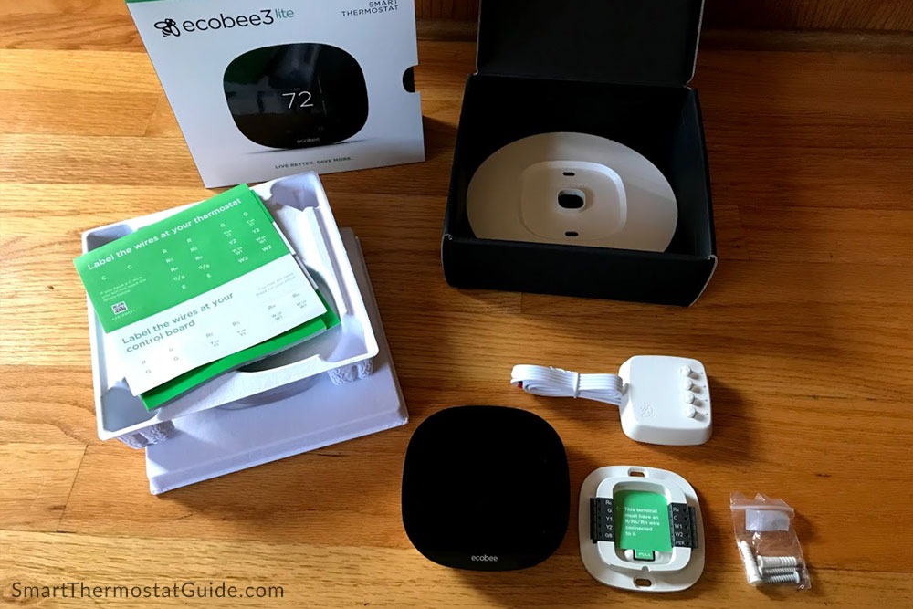 ecobee3 lite box contents: instruction manuals, optional wall plate (to hide paint differences or wall damage left by your previous thermostat), the ecobee3 lite unit, the Power Extender Kit for optional use inside your furnace, the thermostat backplate, and some mounting screws.