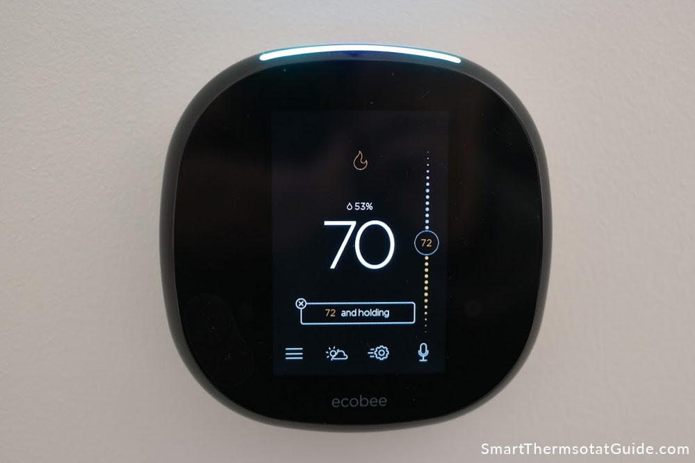 Photo of ecobee 4 thermostat in heating mode
