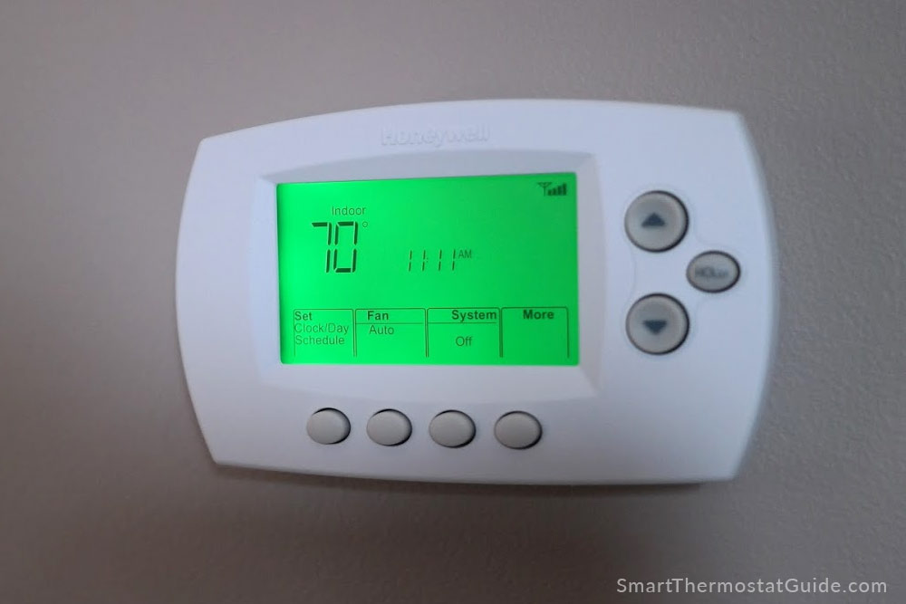 Honeywell RTH6580WF thermostat on the wall and running