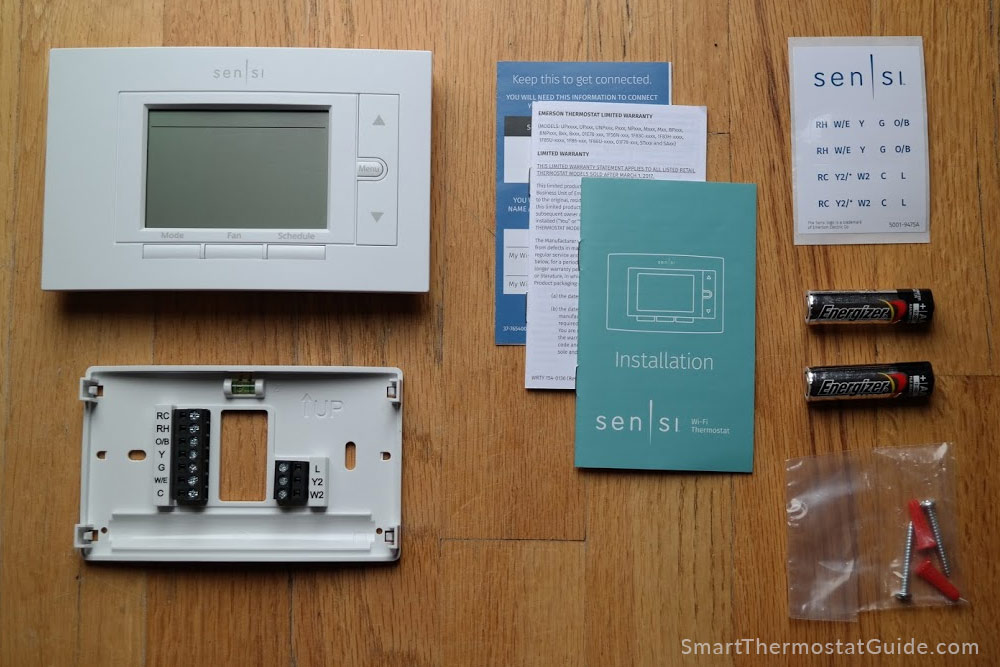 In the box: thermostat unit, backplate, installation steps, wire stickers, two AA batteries, and mounting screws