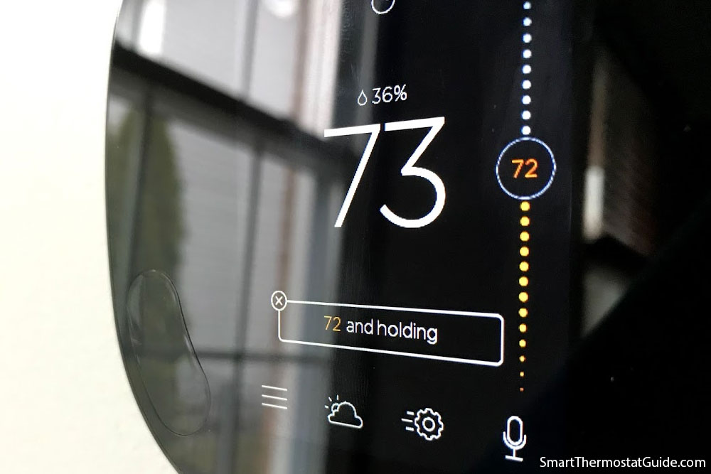 Photo showing a close-up of the Ecobee's display. Slight pixelization is noticeable on some rounded elements.