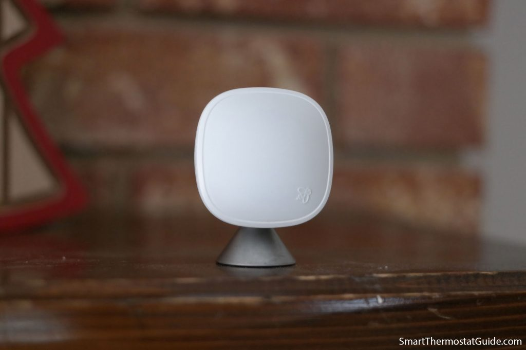 Close up photo of the Ecobee SmartSensor, a small white rounded square on a conical base.