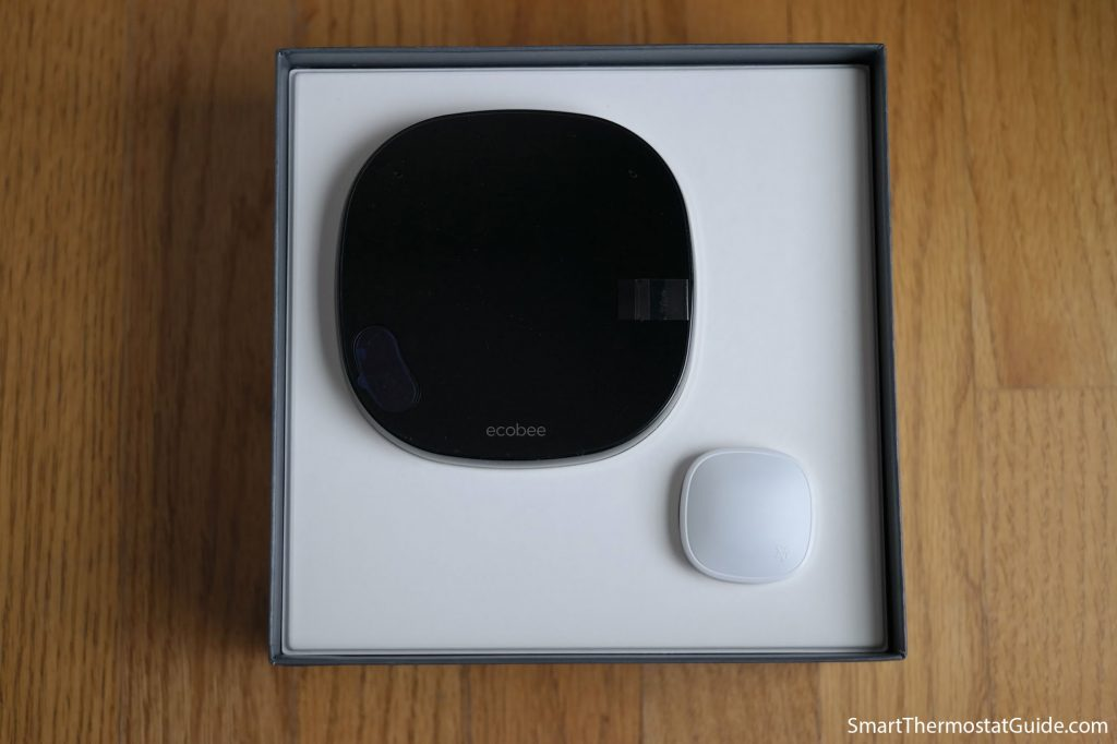 Photo of the ecobee SmartThermostat and SmartSensor in the open retail box.