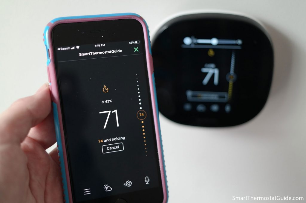 Photo of the Ecobee app and the Ecobee SmartThermostat together. Photo demonstrates that their UI design is very similar.