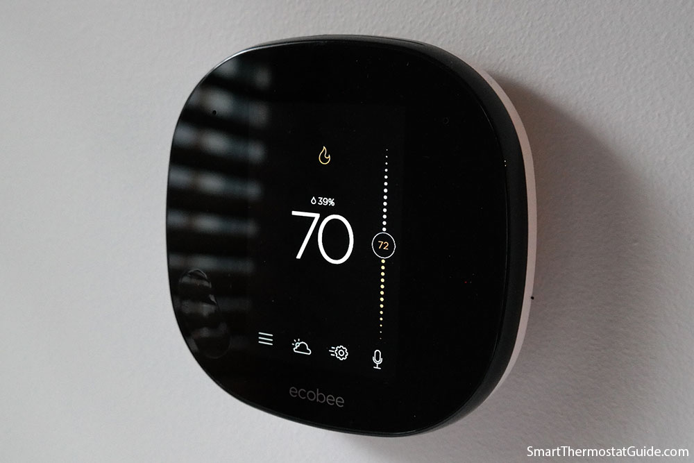 Photo of the Ecobee SmartThermostat heating to 72 degrees. The current temperature is 70.